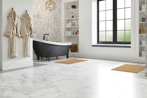 Tile flooring roomscene in a bathroom with a bathtub and shower